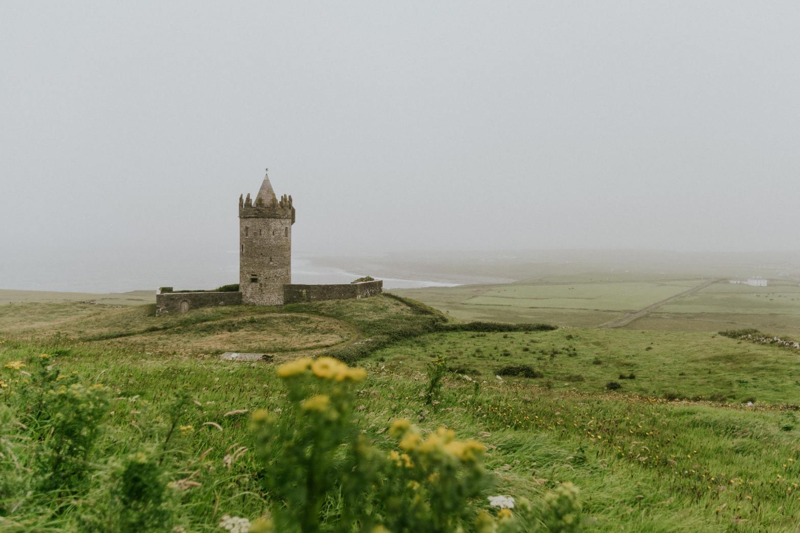 photo of a castle on a hill, Ireland