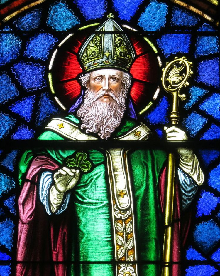 photo of stained glass window showing St. Patrick in green