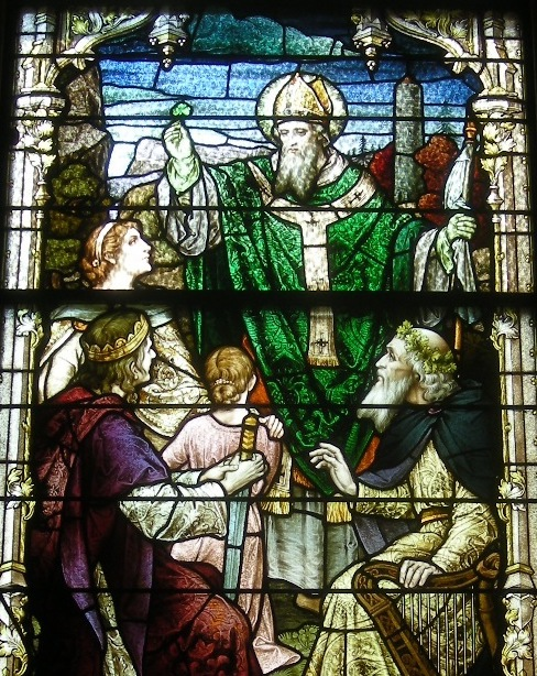 stained glass window showing St. Patrick with women