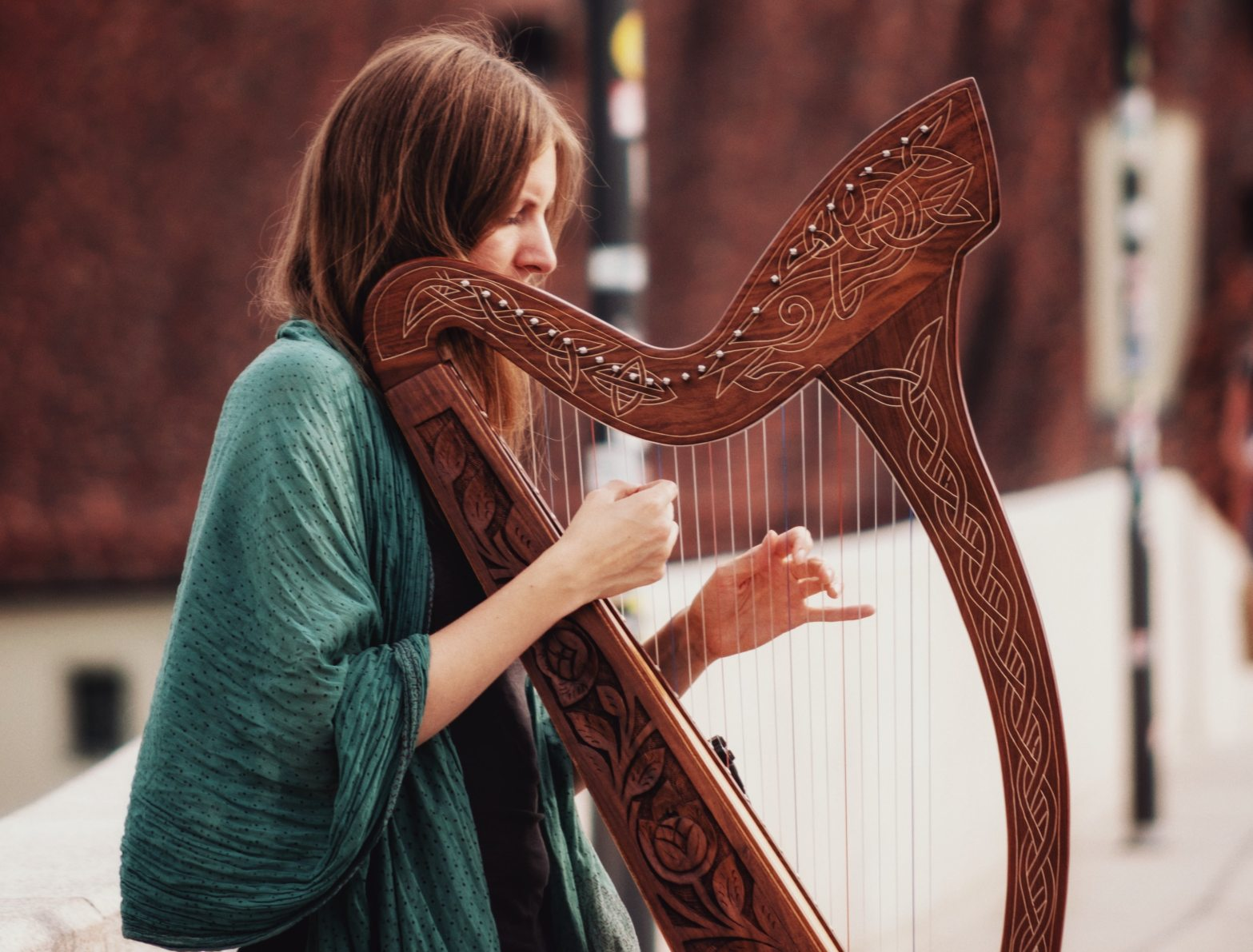 photo of woman playing Celtic harp