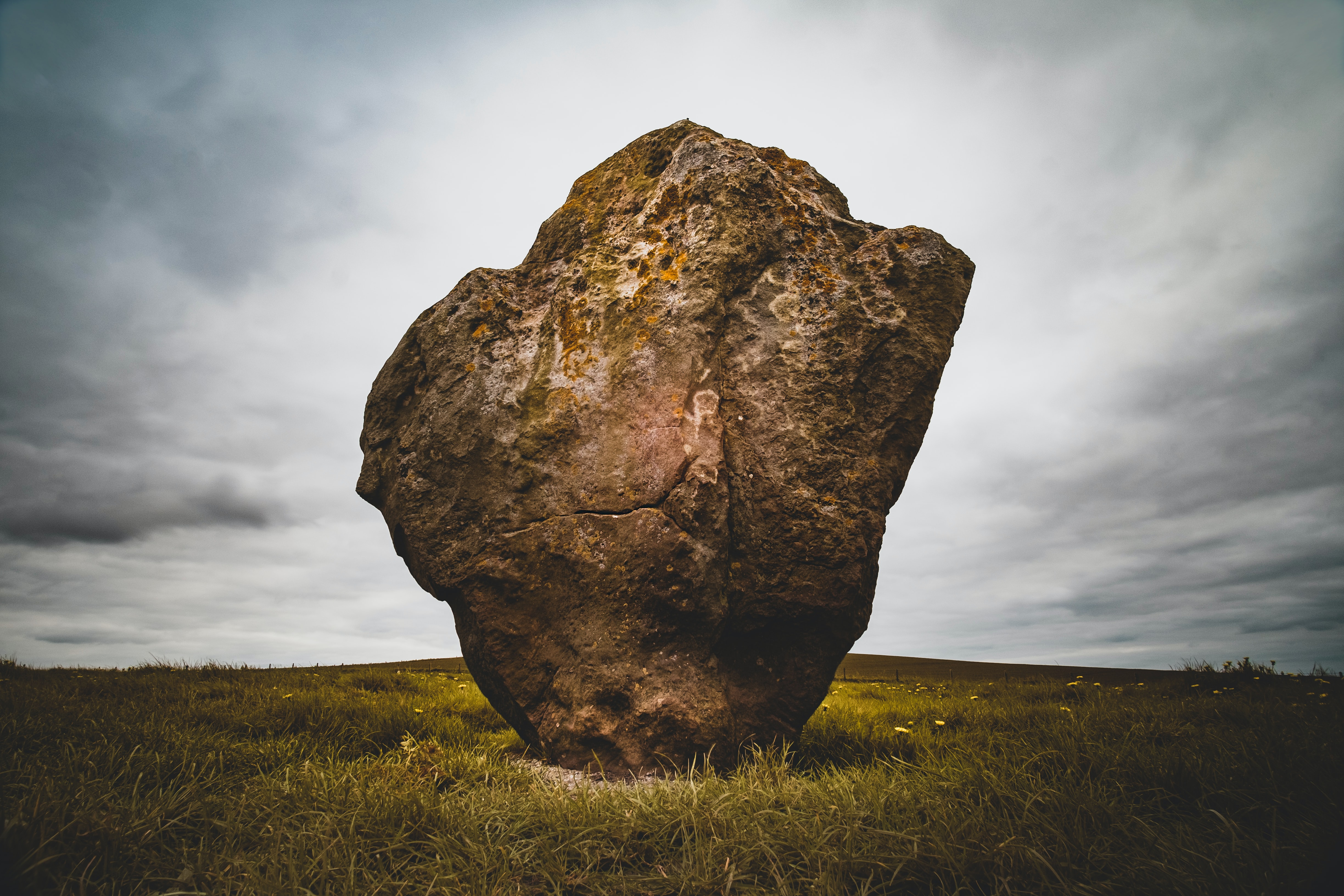 photo of a stone monolith in a field