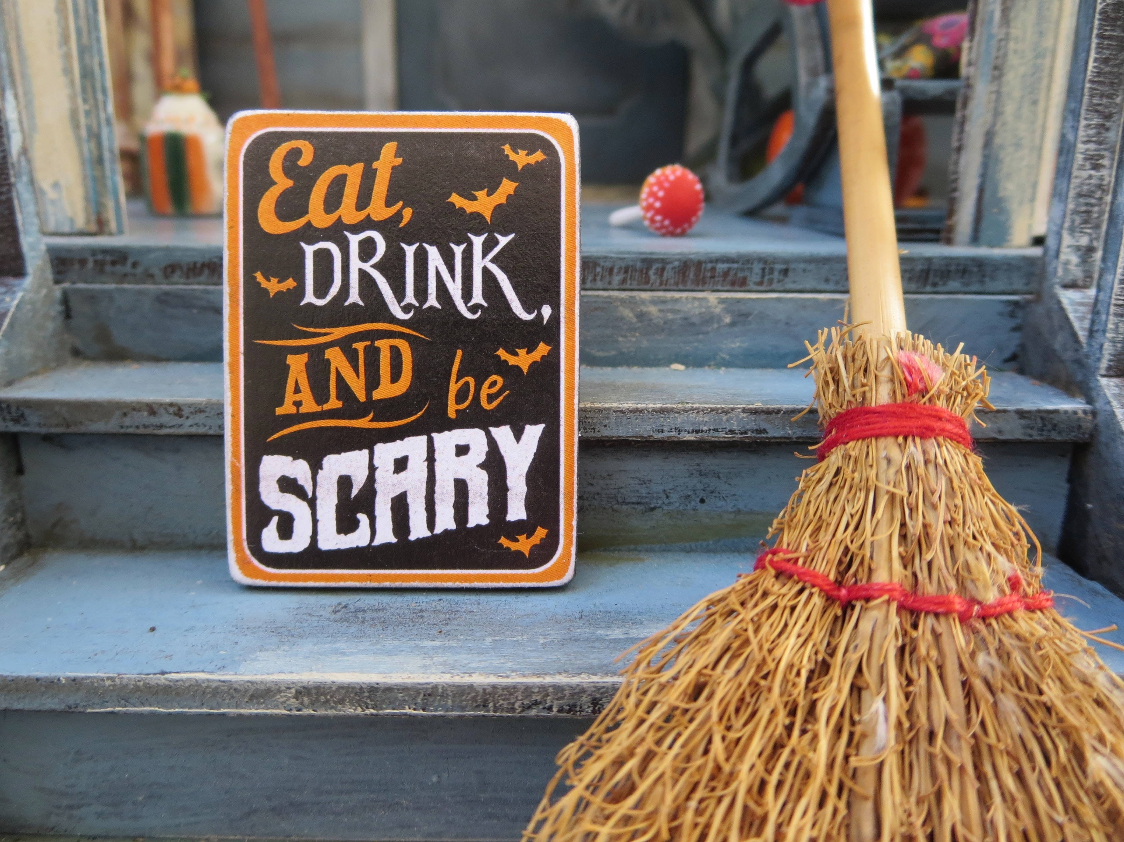 """photo of a black and orange """"eat drink and be scary"""" sign"""