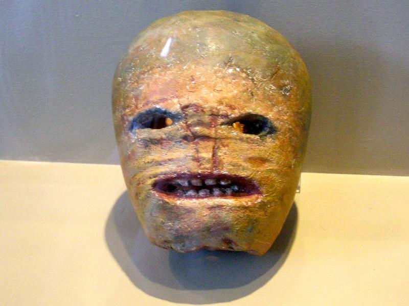 photo of a carved turnip jack-o'-lantern