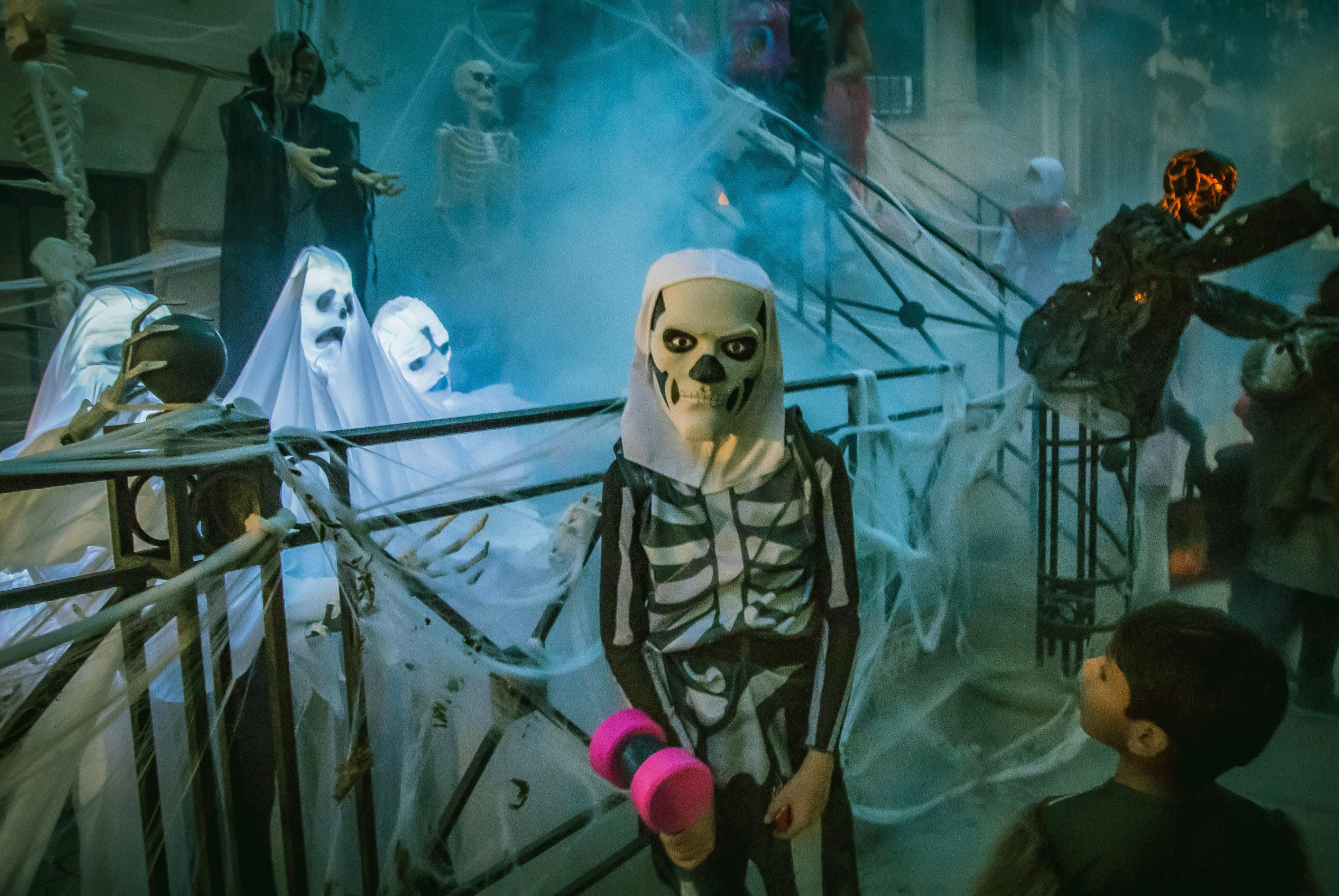photo of kid in skeleton costume