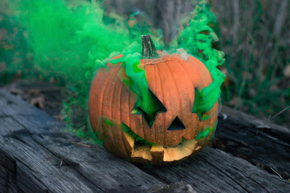 photo of a jack-o'-lantern with green smoke coming out of its eyes